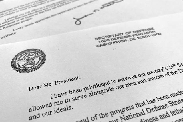 Part of Defense Secretary Jim Mattis' resignation letter to President Donald Trump is photographed in Washington, Thursday, Dec. 20, 2018. Mattis is stepping down from his post, Trump announced, after the retired Marine general clashed with the president over a troop drawdown in Syria and Trump's go-it-alone stance in world affairs. (AP Photo/Jon Elswick)