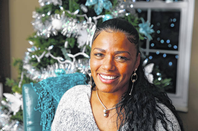 This Dec. 17, 2018 photo shows Tyra Patterson, 43, at her home in suburban Cincinnati. Patterson spent 23 years incarcerated for murder and robbery, crimes she says she did not commit. Patterson said she saw opportunities for self-improvement in prison and made them happen. Mentors have helped make her reentry successful.
