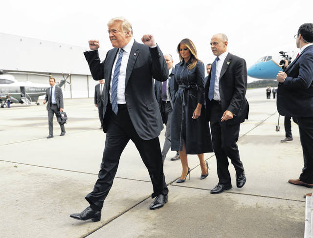 FILE - In this Sept. 11, 2018, file photo, President Donald Trump and first lady Melania Trump arrive at John Murtha Johnstown-Cambria County Airport in Johnstown, Pa.