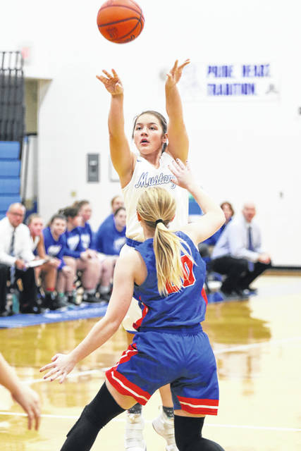 Allen East's Lakin Basham puts up a shot against Crestview's Aleigh Chesbro during Thursday night's Northwest Conference game at Allen East.
