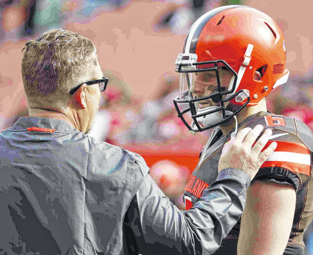 FILE - In this Sunday, Nov. 4, 2018, file photo, Cleveland Browns interim head coach Gregg Williams talks with quarterback Baker Mayfield (6) before his first game as head coach against the Kansas City Chiefs in an NFL football game in Cleveland. As Baker Mayfield threw passes to his receivers and backs before last weeks game against Carolina, Browns interim coach Gregg Williams knew his rookie quarterback was going to have a good game. It wasn't anything Williams saw. It was a sound. (Jeff Haynes/AP Photo, File)