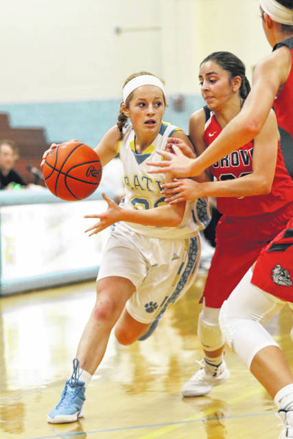 Bath's Chandler Clark drives to the basket against the Columbus Grove's Abby Gladwell during Saturday's game at Bath.