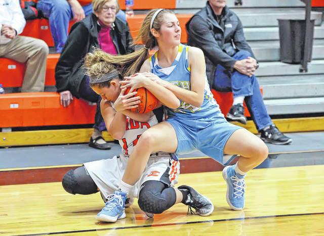 Elida's Erika Suever and Bath's Kaleigh Ketcham fight for a loose ball during Thursday night's Western Buckeye League game at Elida. See more girls basketball photos at LimaScores.com.