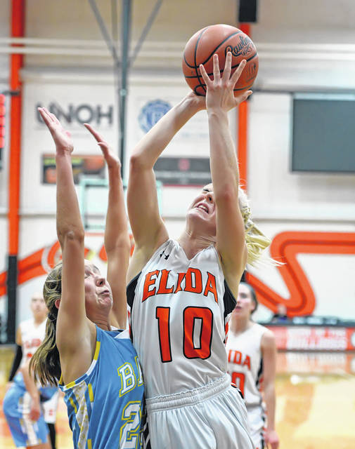 Elida's Hayleigh Bacome puts up a shot against Bath's Ruby Bolon during Thursday night's Western Buckeye League game at Elida.