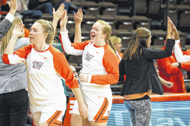 Bowling Green's Kadie Hempfling slaps high fives with teammates. The Ottawa-Glandorf product has been building up team chemistry with her teammates in the first nine games.