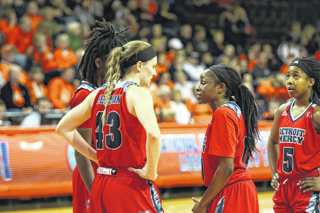 Detroit Mercy's Paige Bellman talks with her teammates during a time out. Despite being a freshman, Bellman has been a starter for the Titans this year and has been working on chemistry with her fellow Titans.
