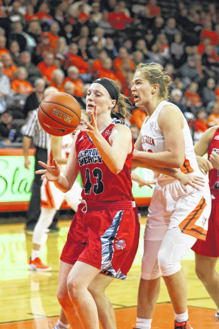 Detroit Mercy's Paige Bellman looks to secure a rebound against Bowling Green State University. The Columbus Grove grad is one of the team leaders in rebounding.