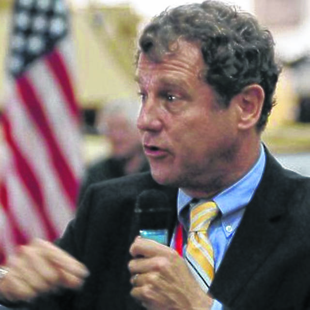 Sherrod Brown is capable of both bashing Trump and casting a vision of fatter pocketbooks for working Americans who've missed out on the benefits of a surging stock market. AP Photo
