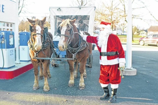Santa traded in his reindeer for a couple of horses while he was in Lafayette Sunday.