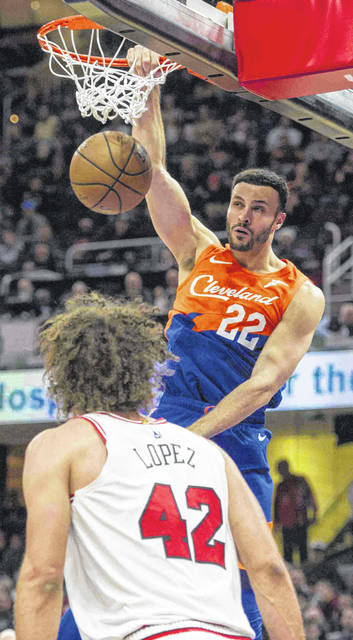 Cleveland Cavaliers' Larry Nance Jr. (22) dunks against the Chicago Bulls during the first half of an NBA basketball game in Cleveland, Sunday, Dec. 23, 2018. (AP Photo/Phil Long)