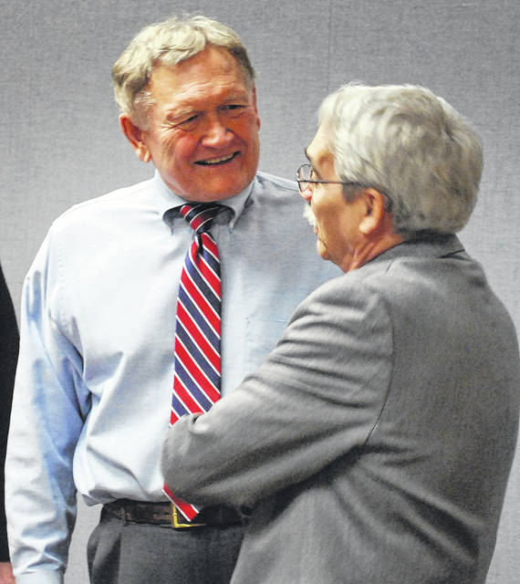 Allen County Juvenile Court Judge Glenn Derryberry and retiring Common Pleas Court Judge David Cheney, at left, exchange pleasantries during a retirement party in Cheney's honor on Friday afternoon.
