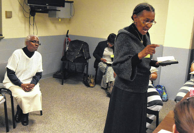"""Barbara Ward, right, reads from the Bible to female inmates at the Allen County jail. Ward has been ministering for more than 40 years. When it comes to who might replace her some day, she replied, """"God will find somebody."""""""