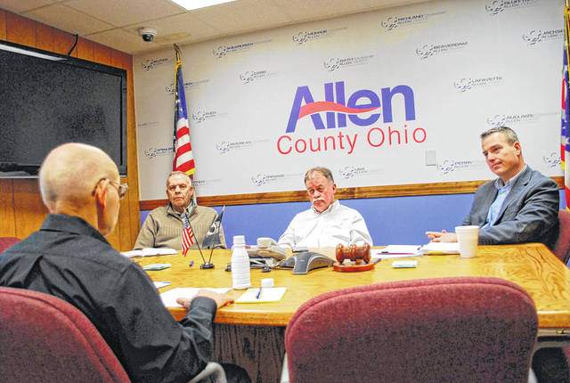 Elida resident Claude Paxton, left, met with the three Allen County commissioners on Thursday to express his concerns about ongoing discussions surrounding the county building department.