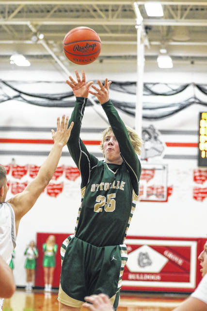 Ottoville's Jaden Schnipke puts up a shot during Friday night's Putnam County battle at Columbus Grove.