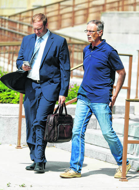 1. Former Allen County Sheriff Sam Crish, right, exits the U.S. District Court in Toledo in June with his attorney, Zachary Maisch.