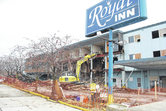 The Royal Inn on Market Street near downtown Lima is rapidly disappearing. Work began on Saturday and continued on Sunday. The city of Lima filed a lawsuit against the owner of the building earlier this year alleging it was a public nuisance and was in violation of several fire and health codes. As part of the resolution of that lawsuit, the owner, Rashmikant Patel, agreed to demolish the structure.