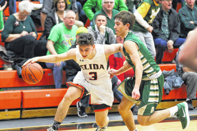 Ottoville's Joseph Miller defends Elida's Drew Biglow during Friday night's game at Elida.