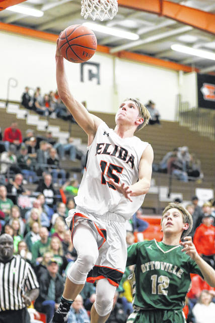 Elida's goes up for a shot against Ottoville's William Miller during Friday night's game at Elida.