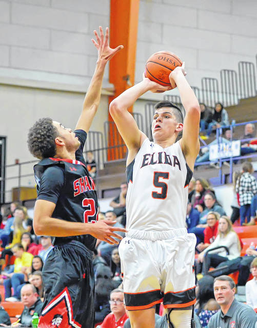 Elida's Dante Wheeler puts up a shot shoots against Shawnee's Sheridan O'Neal during Saturday night's Mercy Health Elida Tip-Off Classic.