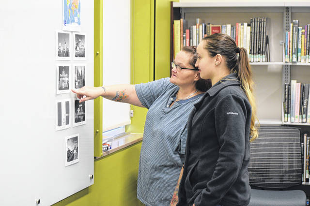 LeAnn Kinnaird and her daughter Lacey Houston try to figure out the clues to the Escape Room at the Lima Public Library, Saturday.