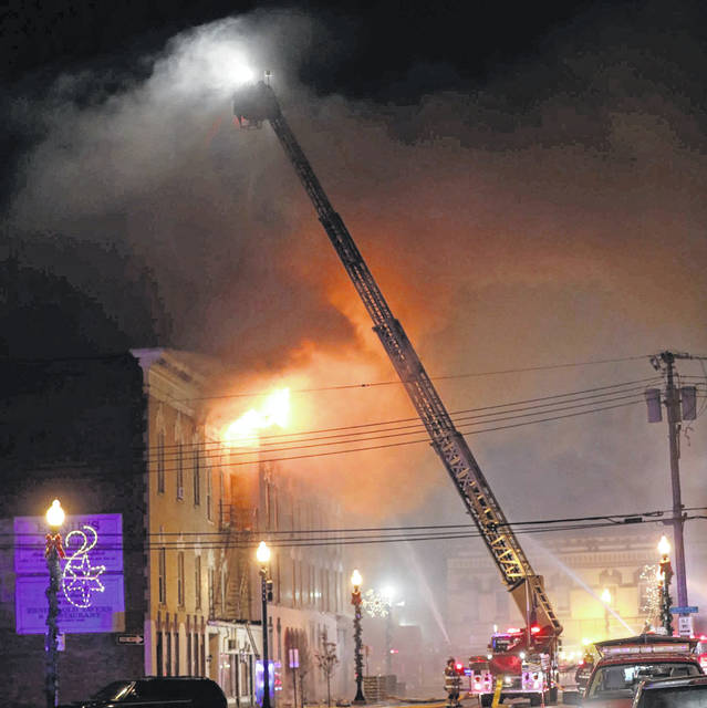 A fire blazes at 1 Perry Street at the Koneta Inn in Wapakoneta on late Sunday evening. The fire displaced more than 20 families, kicking into action Auglaize County's Citizen Emergency Response Team.