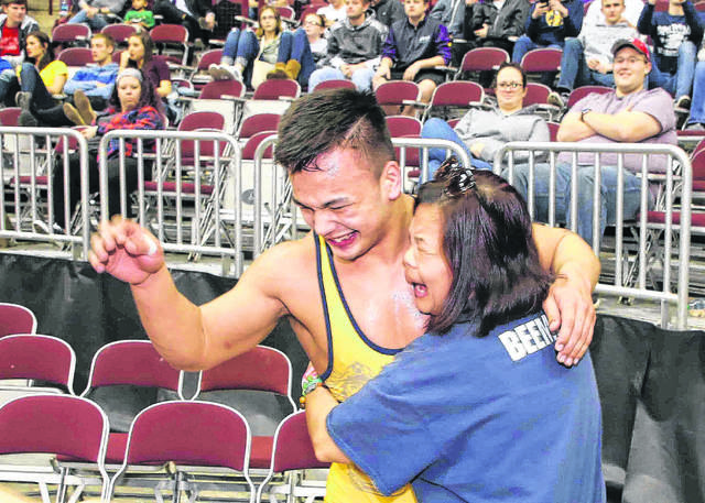 Ottawa-Glandorf's Daniel Beemer gets a hugh from his mother, Marissam after winning the 182-pound state Division III championship Saturday at The Ohio State University's Jerome Schottenstein Center in Columbus. Don Speck | The Lima News