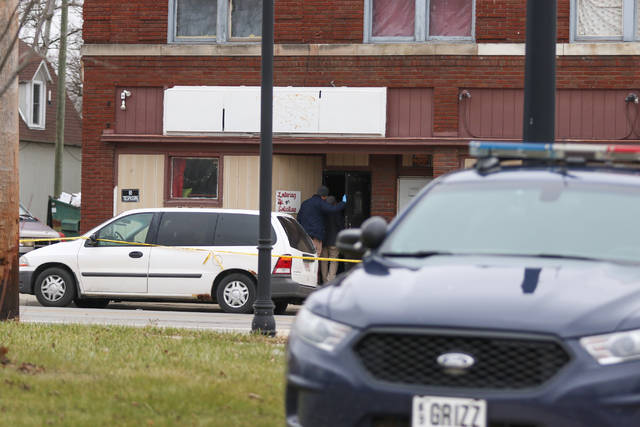 Police tape remains standing after the Lima Police Department responded to 904 S. Main St. at 4 a.m. on Saturday morning on the reports of shots fired. Upon arrival, one person had been killed and three others were injured from gunshots.     Levi A. Morman | The Lima News