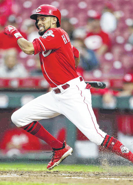 FILE - In this Sept. 9, 2018, file photo, Cincinnati Reds' Billy Hamilton takes off for first base with a single off San Diego Padres relief pitcher Rowan Wick during the seventh inning of a baseball game, in Cincinnati.  A person familiar with the negotiations says the Kansas City Royals and outfielder Billy Hamilton have agreed to a $5.25 million contract for next season that includes up to $1 million in incentives. The person spoke to The Associated Press on condition of anonymity Monday, Dec. 10, 2018,  because the deal was pending a physical.  The career .236 hitter's biggest attribute is his speed — he stole at least 50 bases four straight seasons before dipping to 34 last season. (AP Photo/Gary Landers, File)