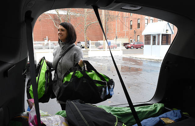 Amanda Pasion of Lima, delivers holiday gift bags to the Allen County Children's Services on Wednesday for children in foster and relative care. The gift bags are part of the Cole Collection Donations. A total of 202 bags will be delivered. Craig J. Orosz | The Lima News