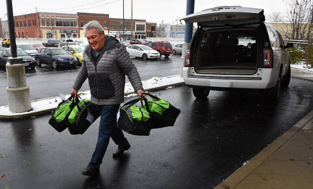 John Whitttaker of Lima, delivers holiday gift bags to the Allen County Children's Services on Wednesday for children in foster and relative care. The gift bags are part of the Cole Collection Donations. A total of 202 bags will be delivered. Craig J. Orosz | The Lima News