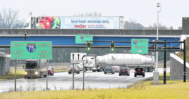 Traffic flows at the intersection and underpass of Interstate 75 and state Route 81 on Friday. Experts say today and Sunday will be big travel days with Wednesday light, if trends hold true.