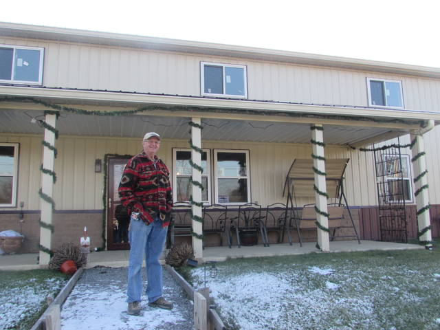 Lima resident Bob Trent is pictured outside his barn style home that is under construction that will provide a living space for he and his wife and a place to store his RV in a shop area.