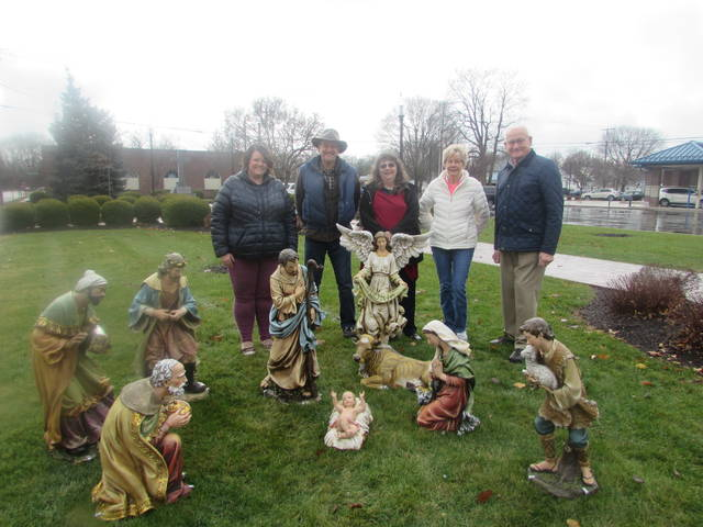 From left standing next to a nativity scene in Our Lord's Park in Ottawa purchased by Ottawa Kiwanis Club are Kendra Kuhlman, Kiwanis president, Bruce Stowe, Kiwanis member and local artist, Nancy Kline, Kiwanis member, Betty Wannemacher, longtime Ottawa resident and Ed Smidebush, Kiwanis financial officer.