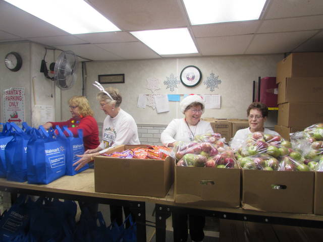 From left organizing food that was given away at the Putnam County Thrift Store Christmas Giveaway are Nancy Macke, thrift store manager, and volunteers Betty Muffley, Bertha Hermiller and Jean Cox.