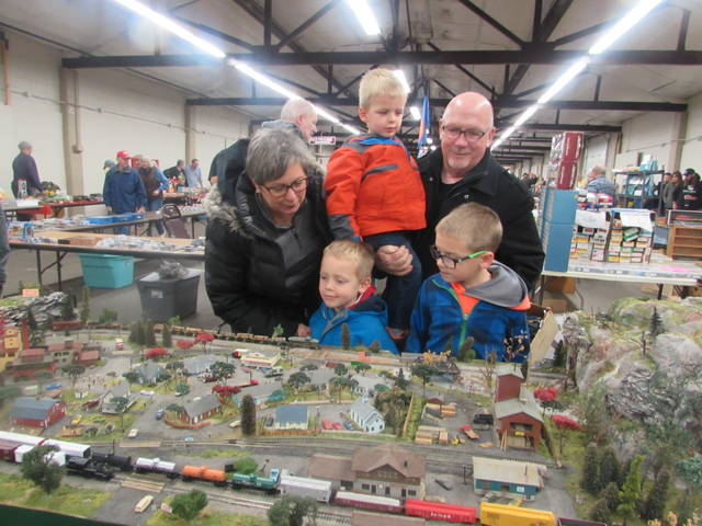 Cathy and Norm Klass, Ottawa, look at a train setup with their grandchildren from left Luke Leopold, 5, Evan, 3, and Noah, 7 at the Allen County Fairgrounds.