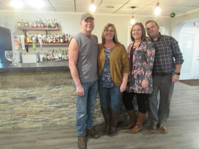 From left are Fort Jennings Whiskey Wine & Bourbon owners Gary and Rose Stechschulte, their daughter, Tiffany Williams and her husband KC Williams.