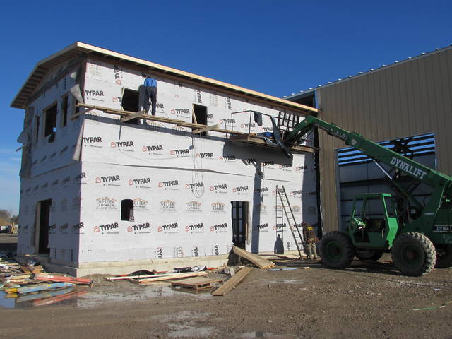 Workers construct an office portion of a new building for Kalida Truck Equipment.