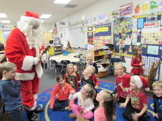 Santa paid a visit to students at Miller City New Cleveland School students Friday and passed out candy and apples.