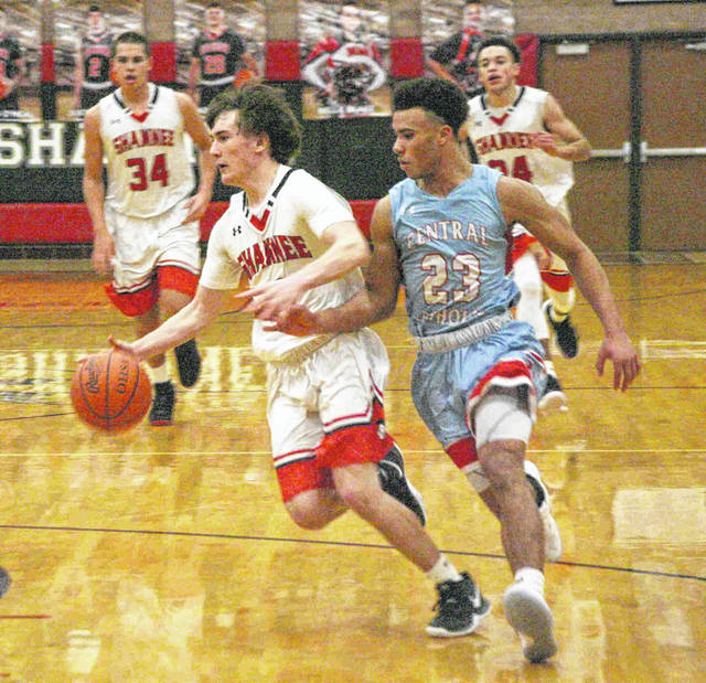 Shawnee senior Justin Behnke tries to push the ball up court as he is hounded by Lima Central Catholic's Shaun Thomas at Shawnee Saturday afternoon. Behnke finished the night with nine points.