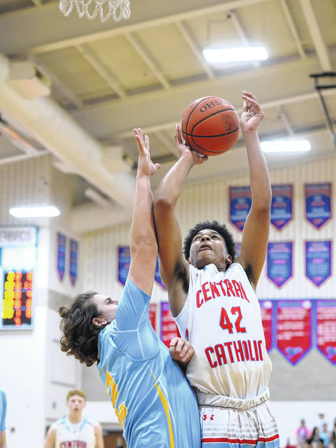 Lima Central Catholic's De'Montre Garner puts up a shot against Bath's Derrick Grigsby during Tuesday night's game at Msgr. Edward C. Herr Gymnasium. See more high school basketball photos at LimaScores.com.