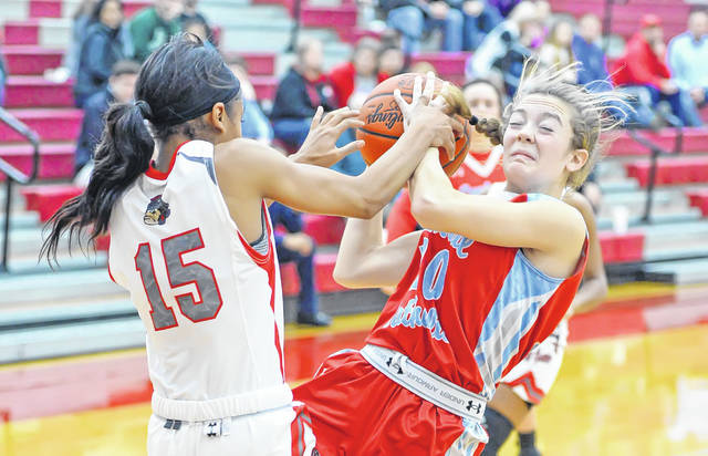 Lima Senior's Destiny McDonald, left, and Lima Central Catholic's Sophia Santaguida battle for control of the ball during Saturday's game at Lima Senior High School. See more girls basketball photos at LimaScores.com.