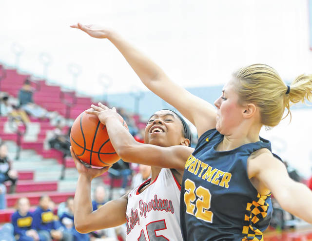 Lima Senior's Destiny McDonald puts up a shot against Toledo Whitmer's Rhegyn Blood during Monday night's Three Rivers Athletic Conference game at Lima Senior High School. See more girls basketball photos at LimaScores.com.