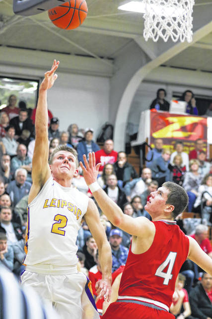 Leipsic's Cole Rieman finds an opening against the defense of Pandora Gilboa's Jared Breece during the Putnam County League game on Thursday night at Leipsic.