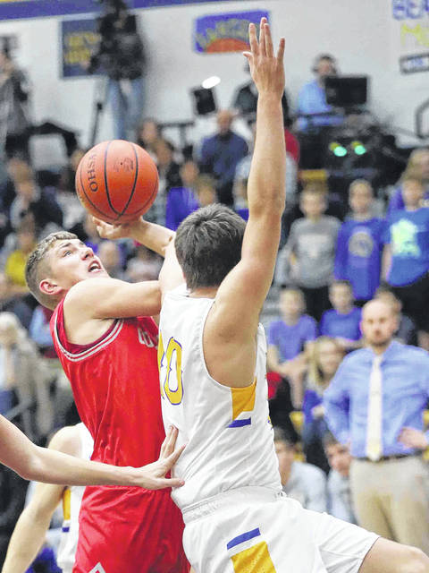 Columbus Grove's Tayt Birnesser puts up a shot against Lincolnview's Ethan Kemler during Friday night's Northwest Conference game at Lincolnview.