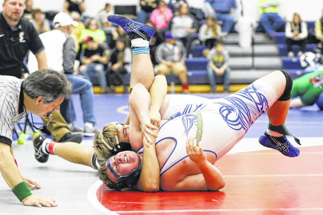 Spencerville's Brandon Dues looks to pin Lincolnview's Louis Ulrey during Saturday's Lancer Invitational at Lincolnview.