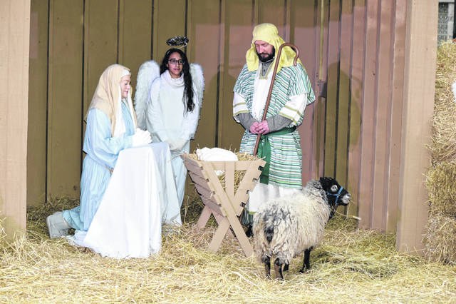 Twenty five actors made the nativity scene come alive Sunday night at St. John Catholic Church in Lima.