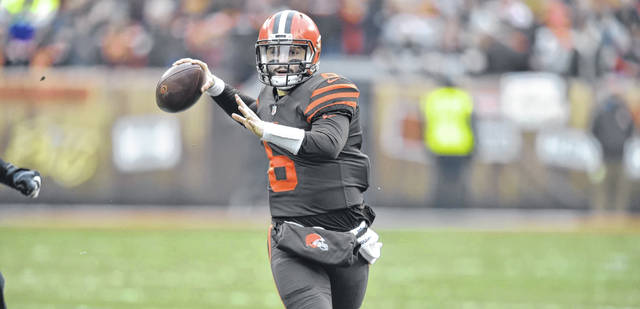 File-This Dec. 23, 2018, file photo shows  Cleveland Browns quarterback Baker Mayfield (6) scrambling in the second quarter an NFL football game against the Cincinnati Bengals, in Cleveland.  Mayfield's reaping rewards for his stellar rookie season. Cleveland's cocky and charismatic quarterback was voted winner of the Joe Thomas Award,  player of the year, on Wednesday by the local chapter of the Pro Football Writers of America. In addition, Mayfield, whose play has sparked the biggest one-season turnaround in club history, was named AFC Offensive Player of the Week after he throwing three touchdown passes in a win over Cincinnati. (AP Photo/David Richard, File)