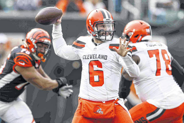 FILE - In this Nov. 25, 2018, file photo, Cleveland Browns quarterback Baker Mayfield passes in the first half of an NFL football game against the Cincinnati Bengals, in Cincinnati. Mayfield had his way with the Bengals defense last month, throwing for four touchdowns in a 35-20 win. Cincinnati's defense has been a bit better heading into the rematch in Cleveland. (AP Photo/Frank Victores, File)