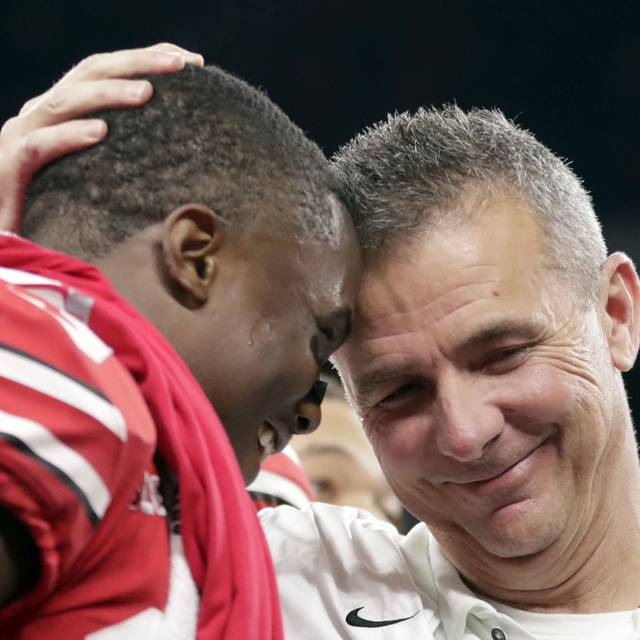 Ohio State coach Urban Meyer and wide receiver Terry McLaurin, left, celebrate after defeating Northwestern in the Big Ten championship.