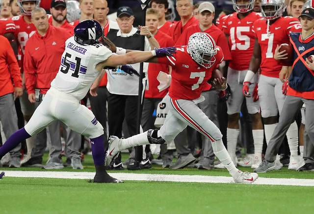 Ohio State's Dwayne Haskins fights for yardage as Northwestern's Blake Gallagher pushes Haskins out of bounds in the first quarter at Lucas oil Field during the Big Ten Championship game Saturday.